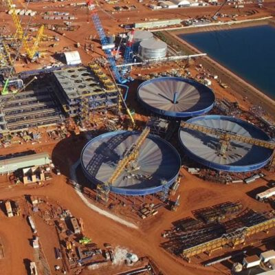 This photograph is of the Roy Hill major project Monford Group was a part of. It shows large tanks and cranes at work in the resource process.