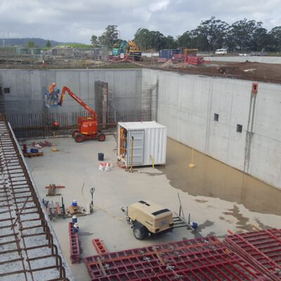 This picture is of a work site Monford Group was contracted to, showing the cranes, trucks and equipment Monford uses to complete big projects on time.
